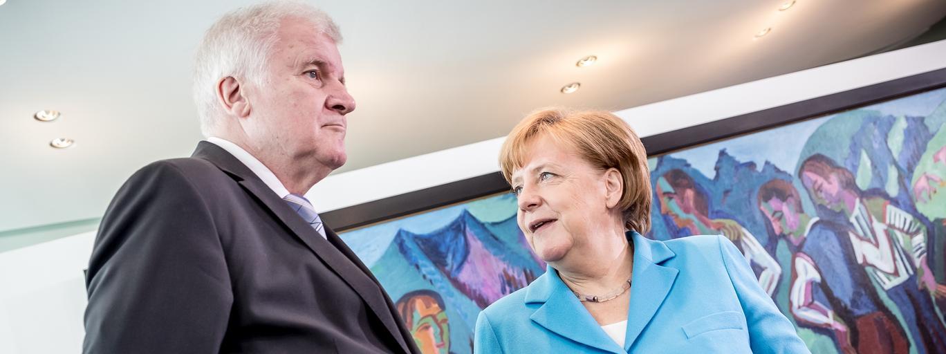 ngela Merkel (Christian Democratic Union - CDU) speaks with interior minister Horst Seehofe