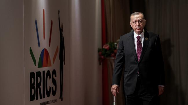 Turkey's President Tayyip Erdogan arrives for a group picture at the BRICS summit meeting in Johannesburg