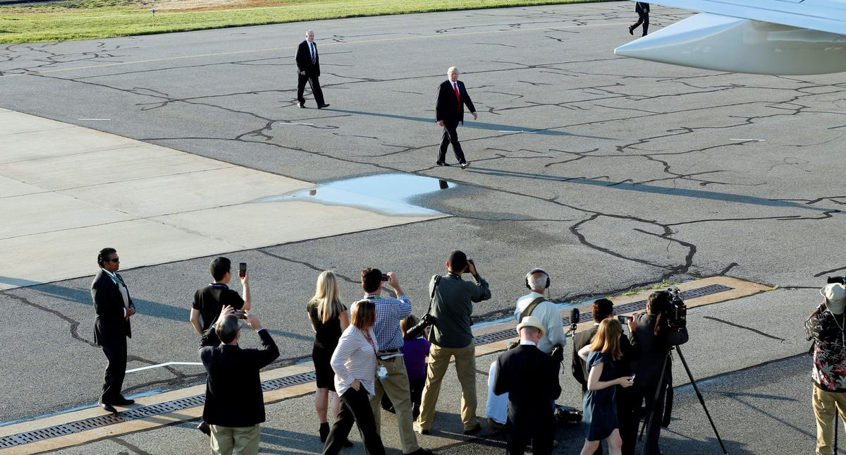 President Donald Trump boards Air Force One at Morristown municipal airport in New Jersey