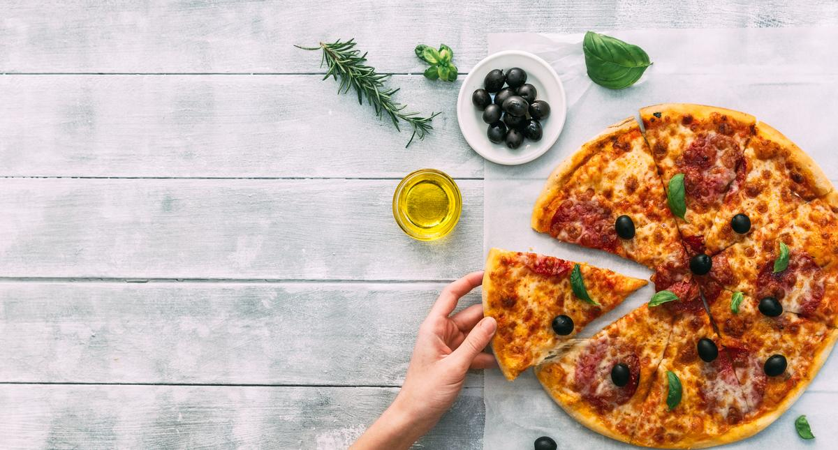 colorful tasty pizza. woman taking piece of italian pizza