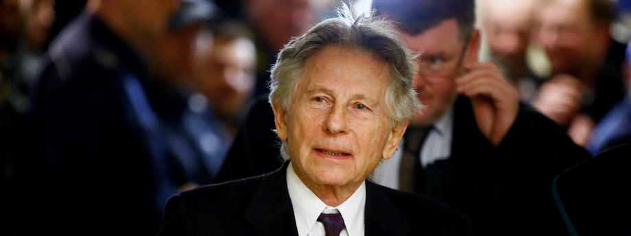 File photo of filmmaker Polanski walking on a corridor during a break of a court hearing in Krakow