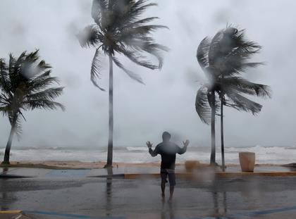 A man reacts in the winds and rain in Luquillo as Hurricane Irma slammed across islands in the northern Caribbean