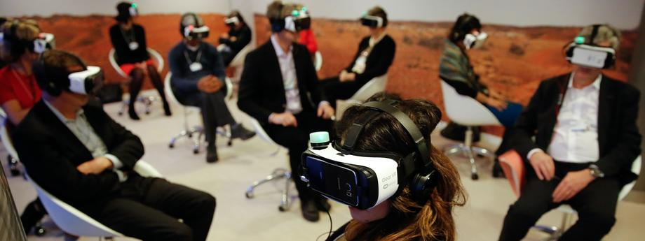 Participants attend the 'Collisions. A Virtual Reality World Premiere' event at the annual meeting of the World Economic Forum (WEF) in Davos