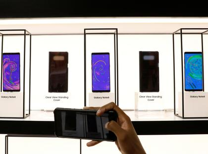 A guest photographs new Galaxy Note 8 smartphone during the launch event in New York