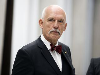 Janusz Korwin-Mikke musi zapłacić 20 tys. zł za spoliczkowanie Michała Boniego