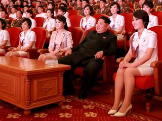 FILE PHOTO: North Korean leader Kim Jong Un and wife Ri Sol Ju enjoy an art performance given by the Chongbong Band to mark the 70th anniversary of the founding of the Workers' Party of Korea (WPK) in this undated KCNA photo