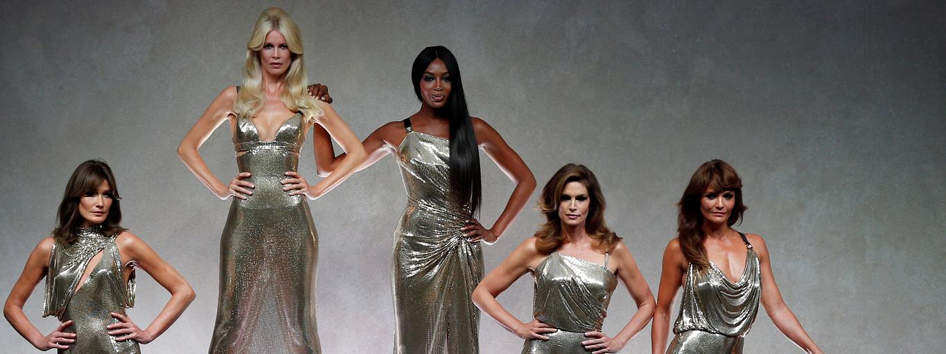 Former top models Carla Bruni, Claudia Schiffer, Naomi Campbell, Cindy Crawford and Helena Christensen display iconic creations of late Italian designer Gianni Versace's during the Versace Spring/Summer 2018 show at the Milan Fashion Week in Milan