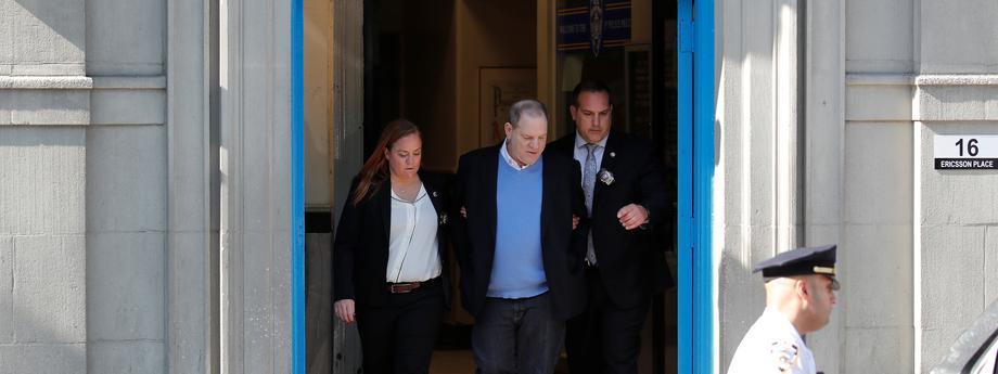 Film producer Harvey Weinstein leaves the 1st Precinct in Manhattan in New York