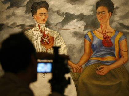 Cameraman films Frida Kahlos painting at Mexico City's Bellas Artes museum