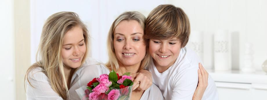 Children offering bunch of flowers on mother's