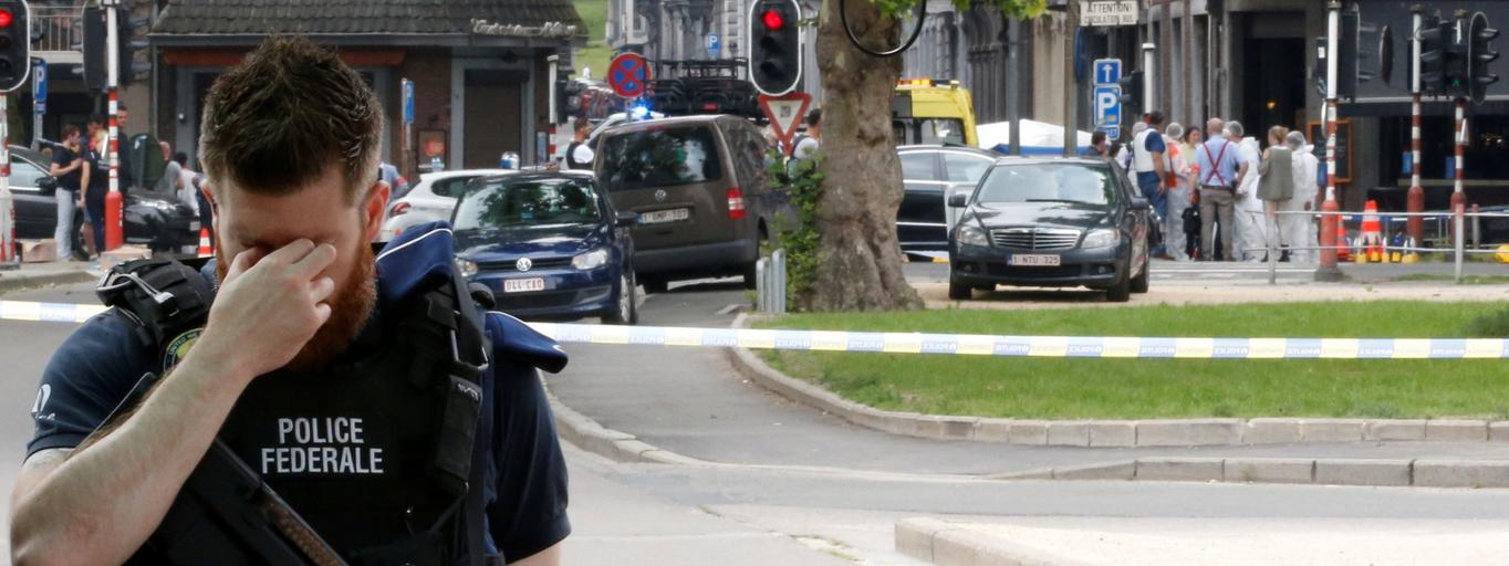 A police officer is seen on the scene of a shooting in Liege