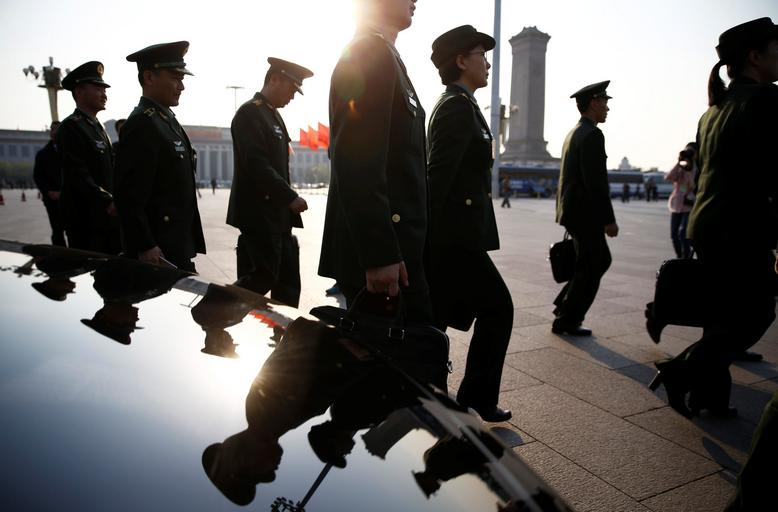 Military delegates arrive for the closing ceremony of NPC at the Great Hall of the People in Beijing