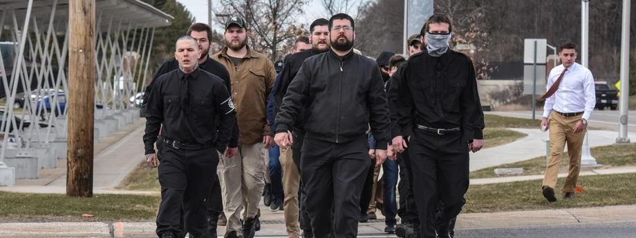 Members of the alt-right including Matthew Heimback from the Traditionalist Workers Party arrive onto the campus of Michigan State University for a Richard Spencer speech in East Lansing, Michigan