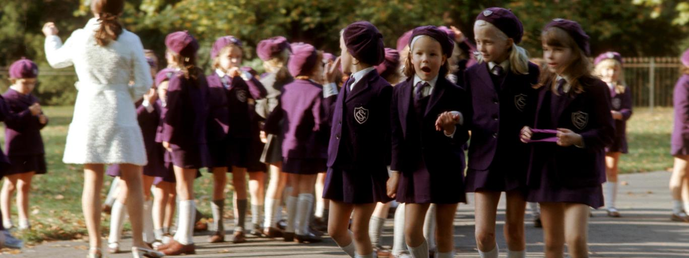Schoolchildren in uniform walking in Hyde Park, London