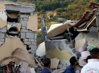 Collapsed houses are seen after an earthquake hits the island of Ischia, off the coast of Naples
