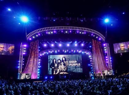 People listen to Gillan of Deep Purple speaks onstage at the 31st annual Rock and Roll Hall of Fame Induction Ceremony at the Barclays Center in Brooklyn