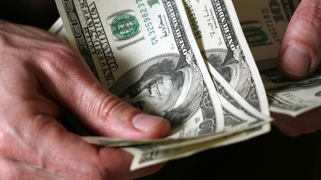 Man's hands hold dollars banknotes money