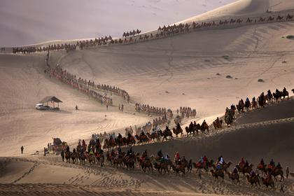 Tourists Visit Sand Dunes IN China