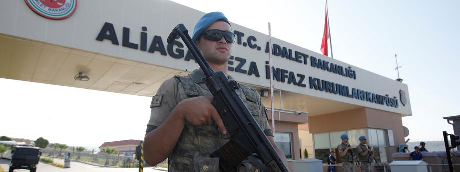 A Turkish soldier stands guard in front of the Aliaga Prison and Courthouse complex in Izmir