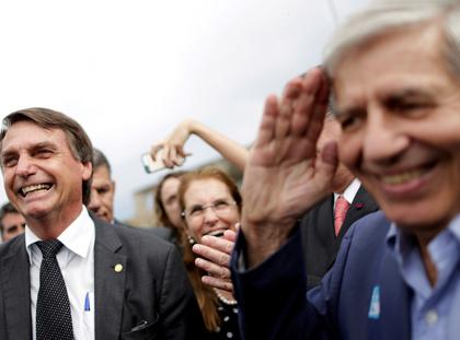 FILE PHOTO: Federal deputy Jair Bolsonaro speaks with Augusto Heleno Pereira, during a protest against former Brazilian president Luiz Inacio Lula da Silva, in Brasilia