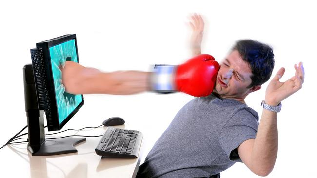man with computer hit by boxing glove social media cybermobbing