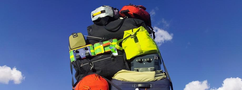 Luggage stacked on car roofrack, low angle view