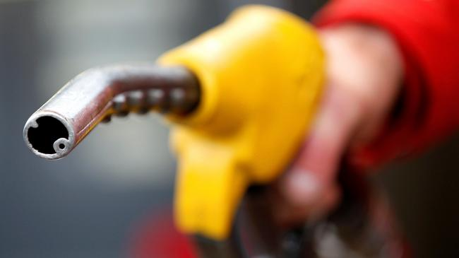 FILE PHOTO: An attendant prepares to refuel a car at a petrol station in Rome
