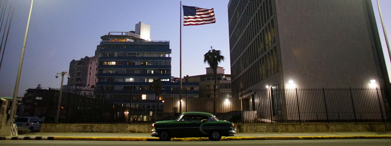FILE PHOTO: A vintage car passes by in front of the U.S. Embassy in Havana, Cuba