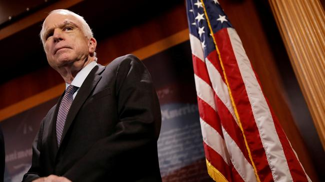 FILE PHOTO - Senator John McCain (R-AZ) looks on during a press conference about his resistance to t