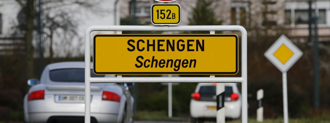 A street sign marks the beginning of the small Luxembourg village of Schengen