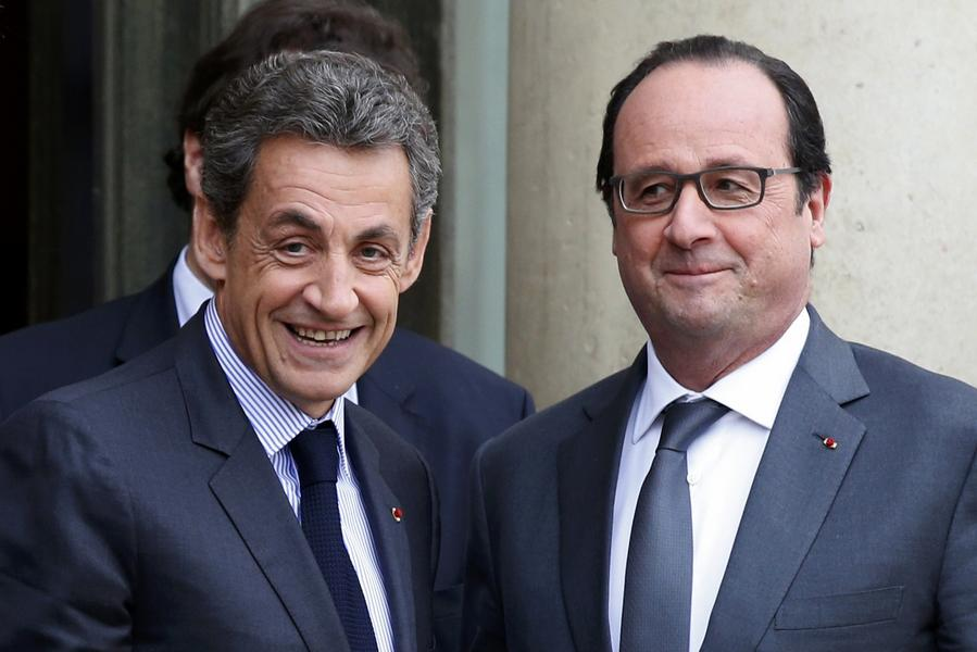 File photo of French President Hollande who stands with Sarkozy, former president and current head of the Les Republicains political party at the Elysee Palace in Paris