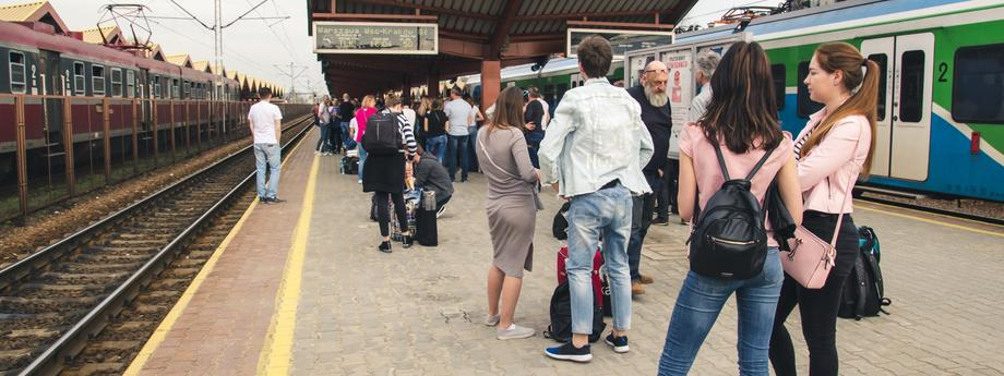 Many people with Luggage on the platform waiting for the delayed train