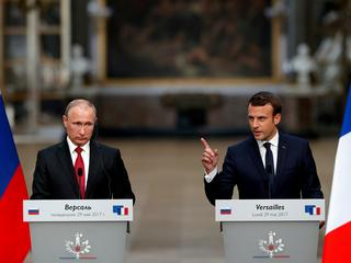 French President Emmanuel Macron and Russian President Vladimir Putin give a joint press conference at the Chateau de Versailles before the opening of an exhibition marking 300 years of diplomatic ties between the two countries in Versailles