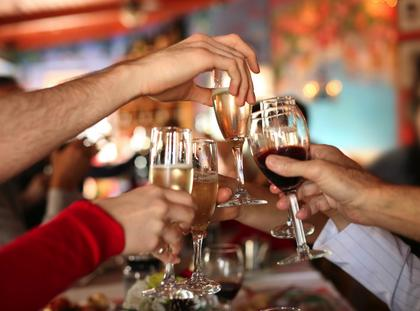 Celebration. Glasses of champagne and wine in hands.
