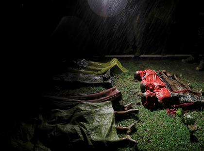 Bodies of children and other Rohingya refugees are covered after their boat with passengers fleeing from Myanmar capsized off the Inani beach near Cox's Bazar