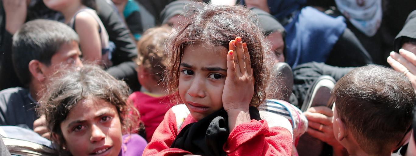 Syryjscy uchodźcy po na syryjsko-tureckiej granicy