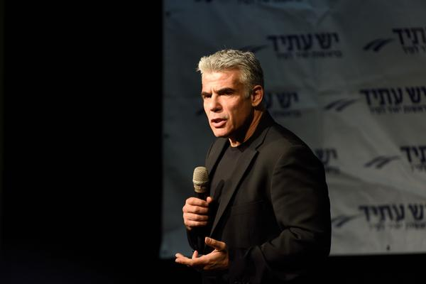 Yair Lapid, leader of 'Yesh Atid' Party and former Israeli Finance Minister speaks to supporters in