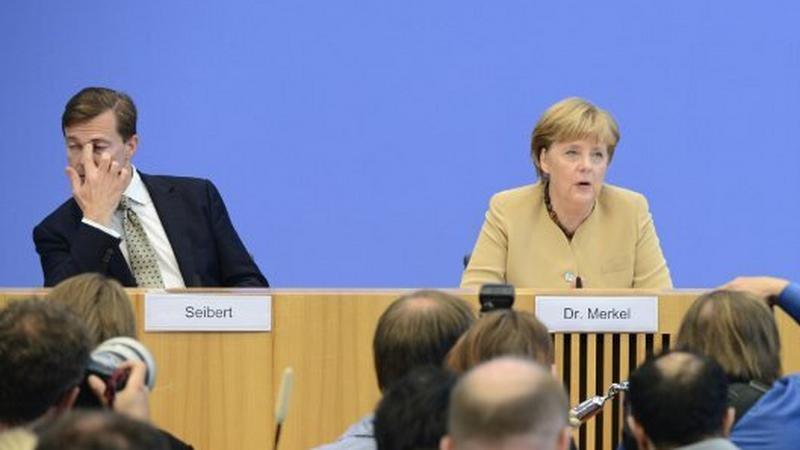 Steffen Seibert i Angela Merkel