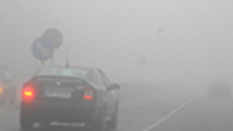 Światła w deszczu i mgle