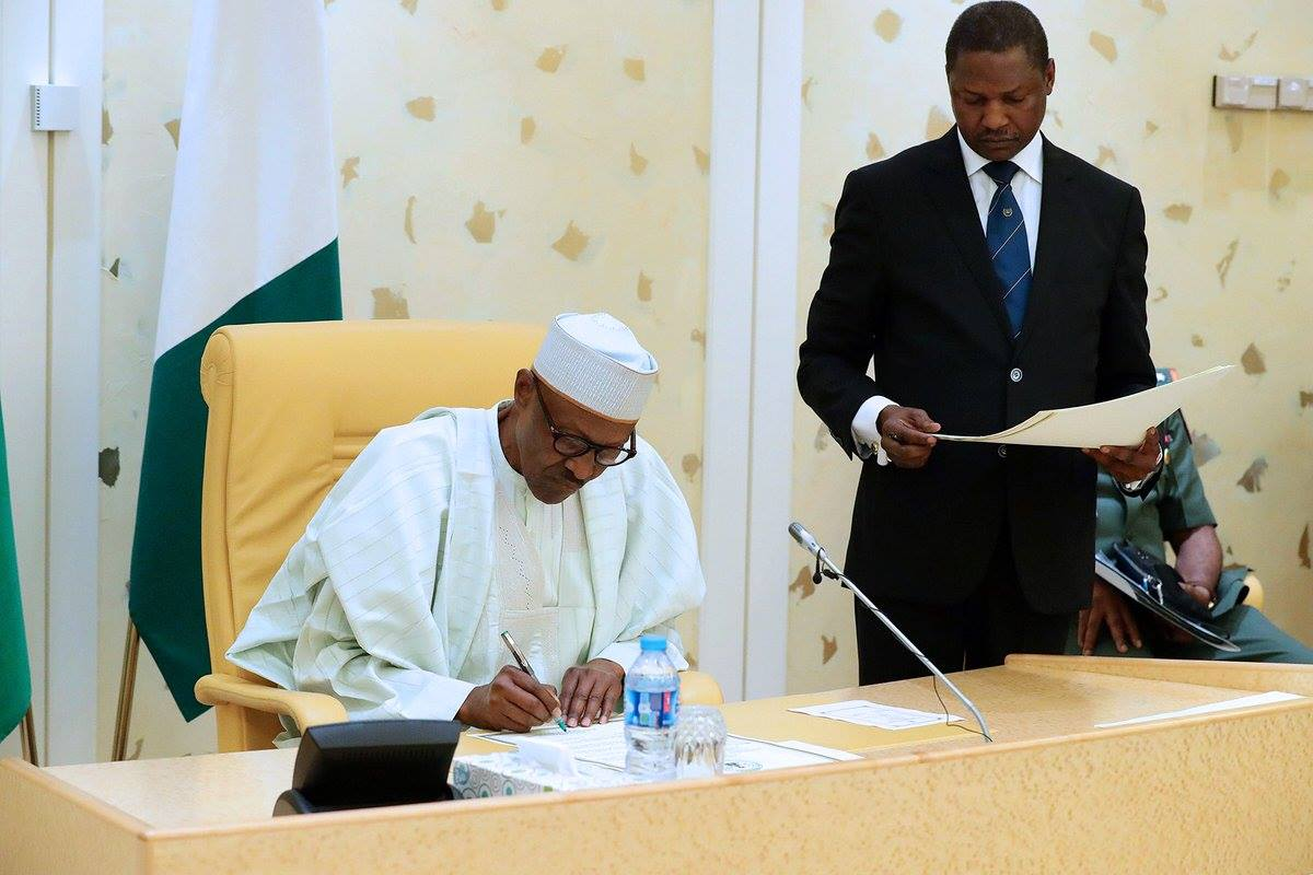 buhari signing the news nigeria