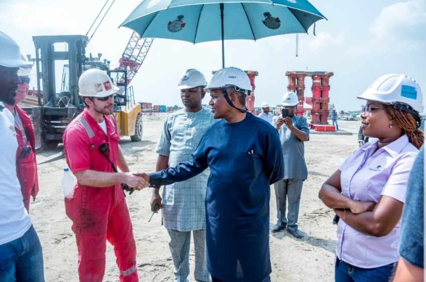Aliko Dangote and other officials at Dangote Refinery site
