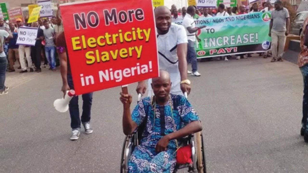 A physically challenged customer leads NLC protest over increase  in electricity tariff in Benin).