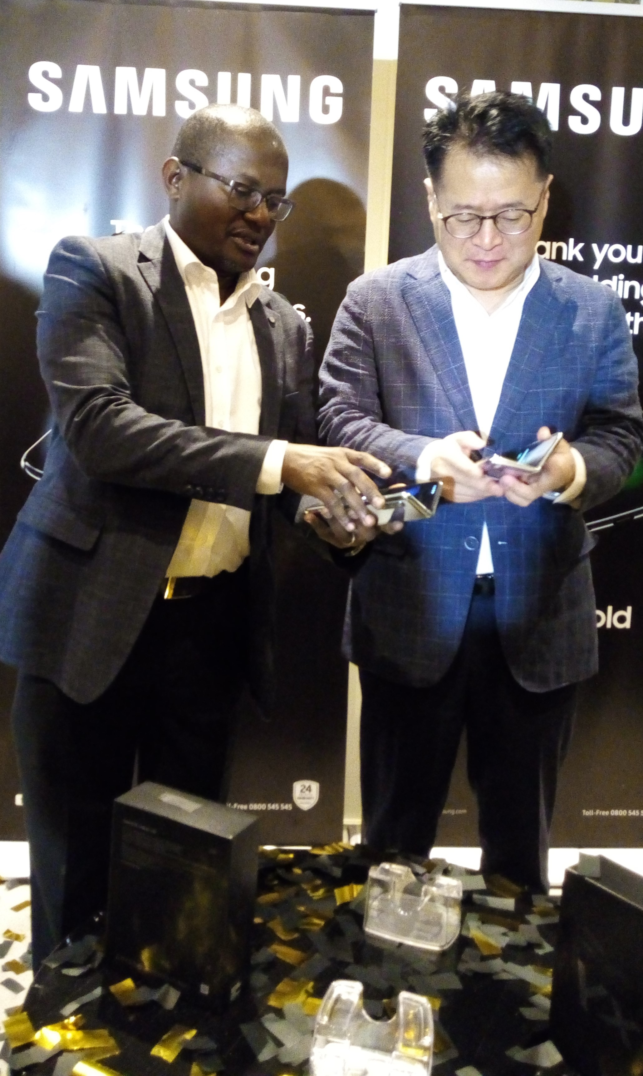Charles Kimari, Samsung Electronic East Africa, Head of Mobile Division (L) with Seok Min Hong, Managing Director of Samsung Kenya Branch (R) experience the Galaxy fold during the launch. (George Tubei)