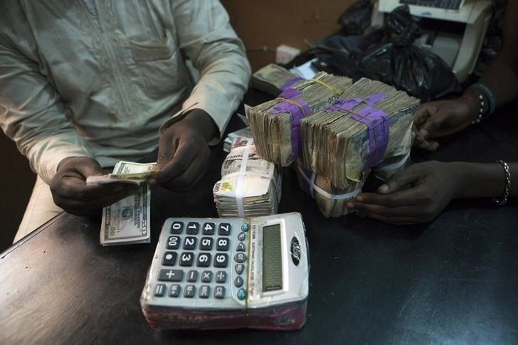 Nigeria's naira hits record low of 412 to dollar on parallel market - traders