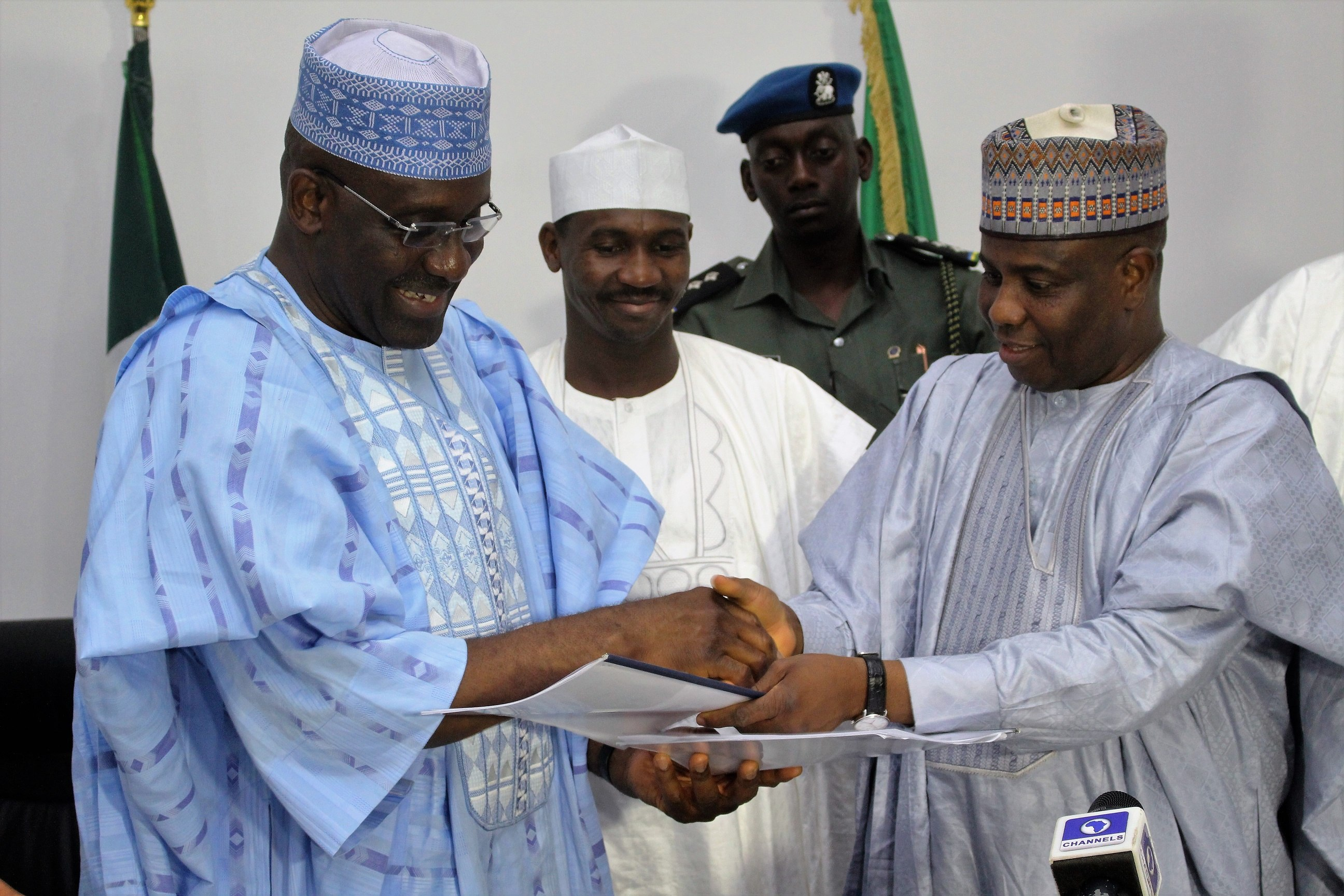 L-R: Ag Managing Director of Bank of Industry, Mr. Wahid Olagunju with Sokoto State Governor, Aminu Waziri Tambuwal, after the signing of agreement to provide N2billion to SMEs in Sokoto. Middle of Deputy Governor Ahmed Aliyu....Thursday 05/05/2016