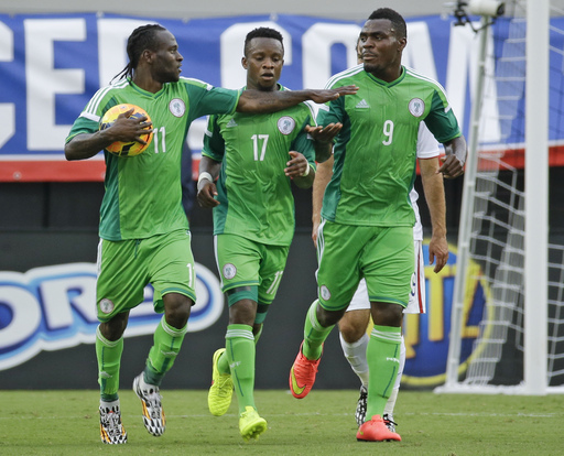 Victor Moses (left) also played with Emmanuel Emenike (right) with the Super Eagles for several years.