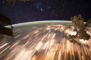 Star trails and blurred terrestrial lights are seen in an image captured by astronauts on NASA's Int