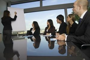 Business training where group of persons is sitting at a table w