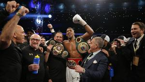 Anthony Joshua celebrates with trainer Robert McCracken and promoter Eddie Hearn after winning the fight