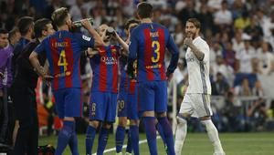 Real Madrid's Sergio Ramos gestures to Barcelona's Gerard Pique after being sent off